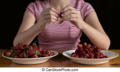 Woman preparing strawberries for jam - Woman preparing...
