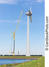Construction site Dutch windturbine with large crane -...