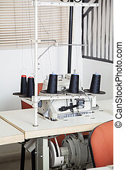 Thread Spools In Sewing Factory - Black thread spools and...