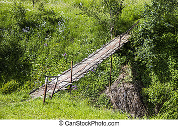 footbridge - wooden footbridge under the small river