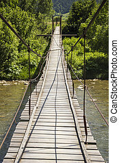 footbridge - wooden footbridge under the fast river