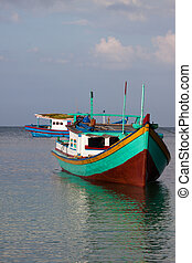 Indonesian Boat front of boat on water