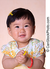 Baby Asian Girl Portrait with yellow dress
