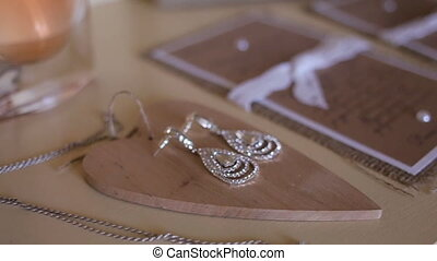 Tracking shot of wedding and bridal accessories on a table,...