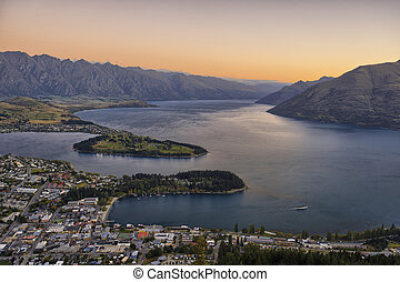 Queenstown at dusk, with Lake Wakatipu and the Remarkables...