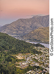 Queenstown at dusk, with the Remarkables in the background,...