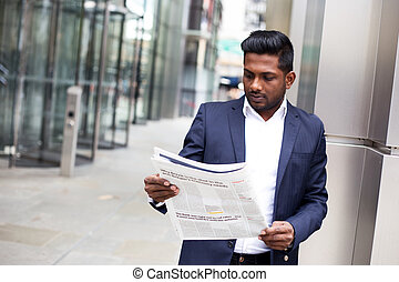 business man reading the newspaper