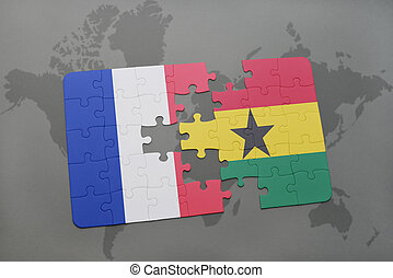 puzzle with the national flag of france and ghana on a world...