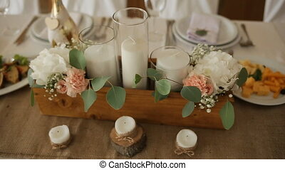 Wedding table setting with nature theme of rustic...