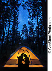 Silhouette Couple Camping Under Stars in Tent - Silhouette...