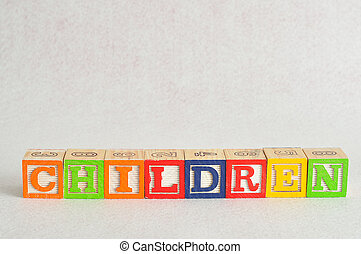 The word children spelled with alphabet blocks isolated on a white background
