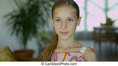 Portrait of a positive emotional little girl with long...