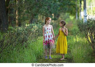 Two cute little girls talking