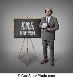 Make things happen text on blackboard with businessman...