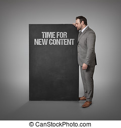 Time for new content text on blackboard with businessman...
