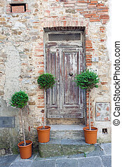 Traditional old wooden doors in Italy with three decorative...