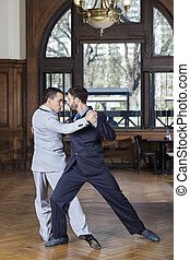 Dancers Performing Argentine Tango In Restaurant - Full...