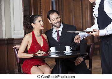 Cropped Image Of Waiter Serving Coffee To Couple - Cropped...
