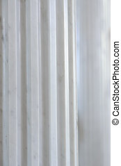 Antique White Marble Fluted Column - A close-up of an...