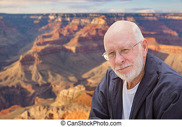 Happy Senior Man Posing on Edge of The Grand Canyon