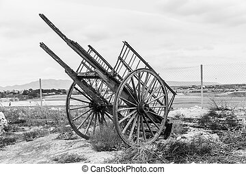 Old wooden wagon - Old broken wooden wagon. Black and white...