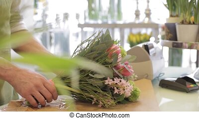 florist and woman buying flowers at flower shop - people,...