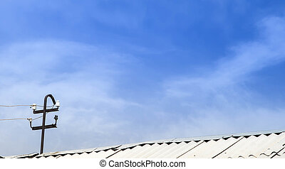 Roof antenna in cloudy sky - conceptual of telecommunication...