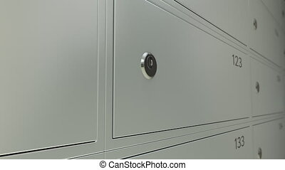 Line of safe deposit boxes in a bank and inserted key with...
