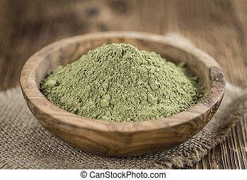 Stevia leaf powder (detailed close-up shot) on rustic wooden...