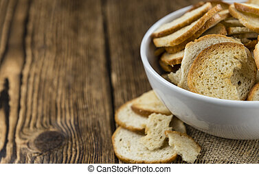 Fresh baked bread chips (close-up shot; selective focus)