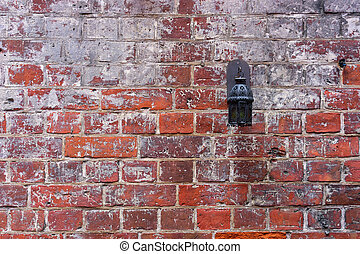 Red brick wall with a lantern