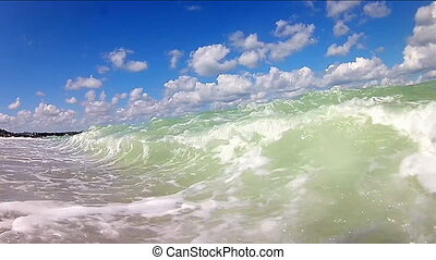 Sea waves with blue sky and clouds. slow motion