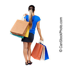 back view of woman with shopping bags backside view of...