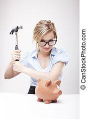 breaking a piggy bank