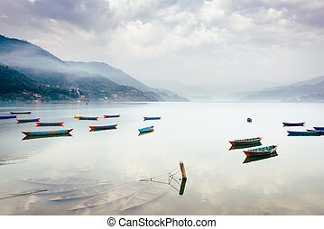 Phewa lake in Pokhara, Nepal - Boats on Phewa Lake in...