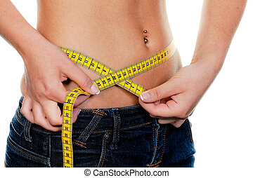 Slim woman with measuring tape measure their figure