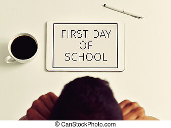 teacher and text first day of school in a tablet