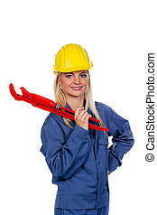 Woman in blue work clothes with pipe wrench - Young woman in...
