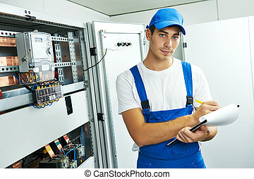 electrician engineer worker with blueprint project -...