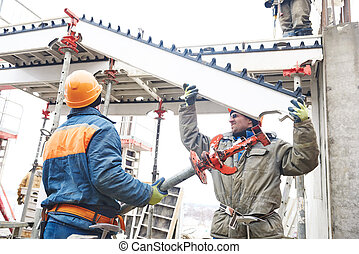 worker installing falsework construction - Construction...