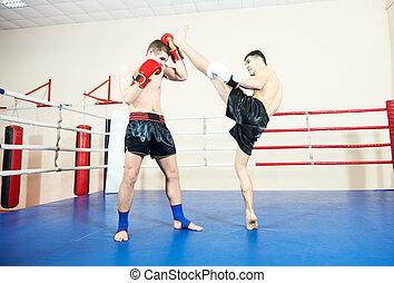 Muay thai boxers at training ring - Muay Thai kickboxing...