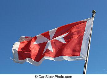 Maltese flag against a blue sky
