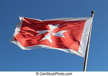 Maltese flag on sky - Maltese flag against a blue sky