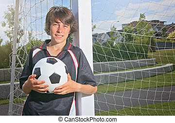 Soccer kid - A soccer player on the play field