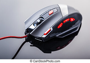 Gaming mouse with red buttons - a sleek modern gaming mouse...