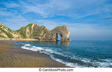 Durdle Door, a natural archway caused by limestone erosion.