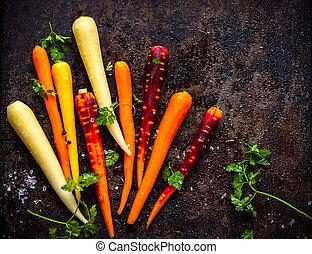 rainbow carrot - raw rainbow carrot for roasting, on a...