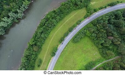 Aerial view of highway, river, forest and grassland during...
