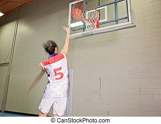 A asian basketball player in gymnase field try to make a...