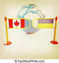Three-dimensional image of the turnstile and flags of Canada...